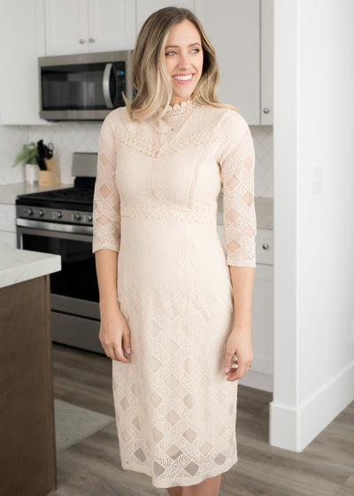 our cream, crisscross lace dress paired with heels.