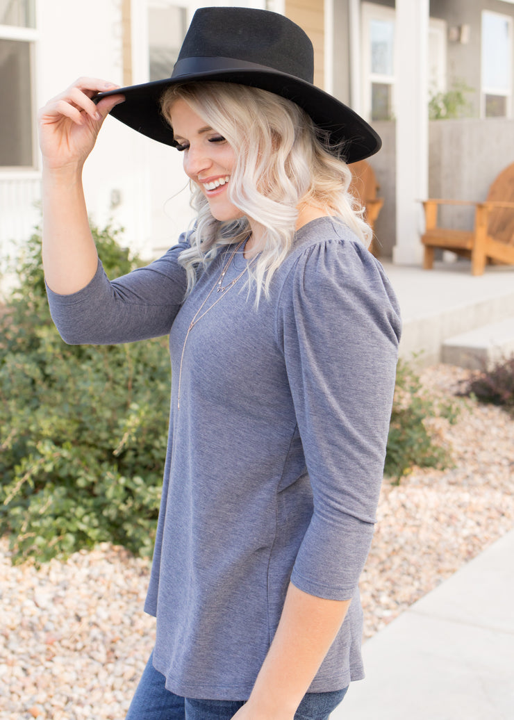 Our navy puff sleeve top paired with jeans.