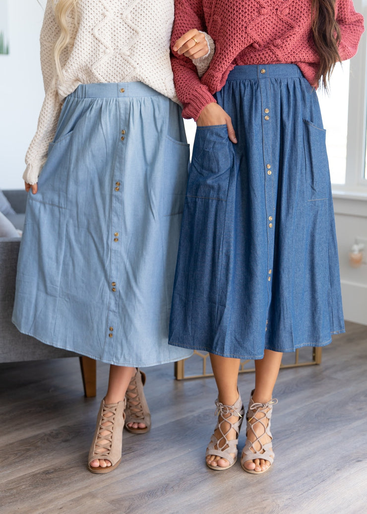 A gorgeous light denim, double button midi skirt. It can be paired with any style of top from a fancier blouse to an animal print top like shown here!