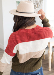 Our red and olive, color block and stripe top paired with jeans.