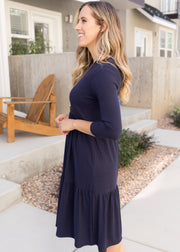 Our navy, ribbed tiered dress paired with booties.