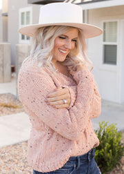 Our blush, confetti sweater paired with jeans.