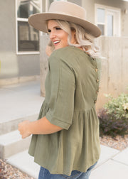 Our olive, peplum top paired with jeans.