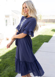 Our navy, embroidered front tie waist dress.