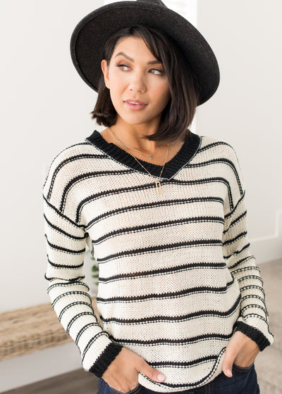 Our ivory and black stripe sweater paired with jeans.