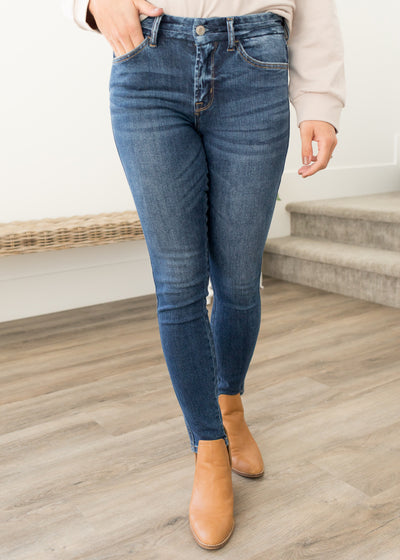 Our medium wash skinny jeans paired with booties.