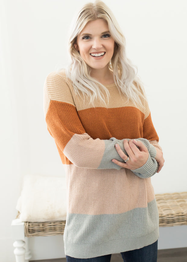 Our taupe, color block tunic length sweater paired with jeans.