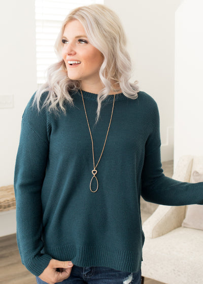 Our teal, knitted sweater paired with jeans.