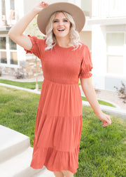 Our burnt orange fit and flare dress.