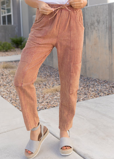 Rust colored, linen style drawstring pants.
