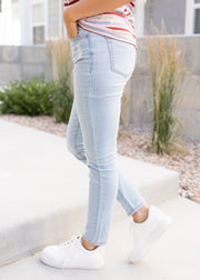 Our light wash, button fly jeans paired with a stripe top.