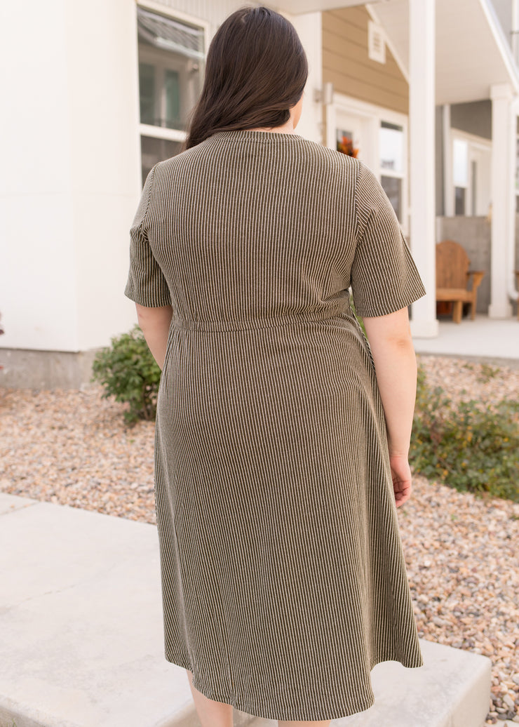 Our olive stripe, plus size dress paired with booties.