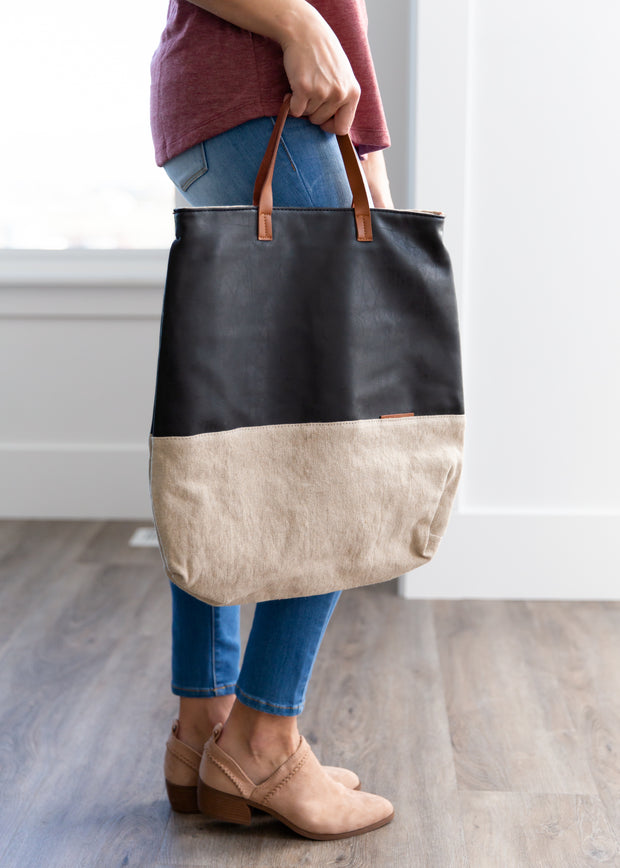 Tan and black faux leather tote.