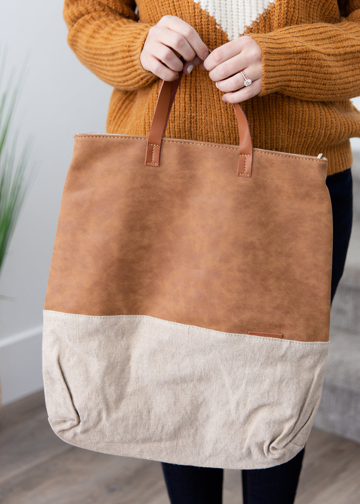 Tan and beige faux leather tote.