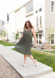 Our olive and ivory pattern tank top dress paired with heels.