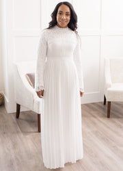 Vanessa is wearing our white, long sleeve, lace and pleated maxi dress.