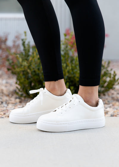 These are our white, leopard lining, platform style sneakers!