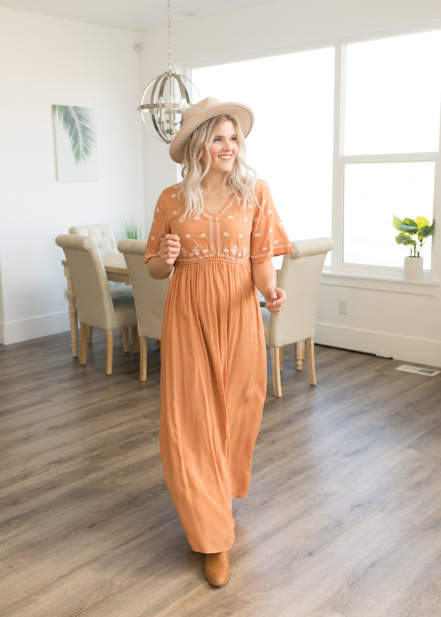 Our light orange, embroidered maxi dress.