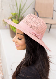 Our rose, woven straw style hat.