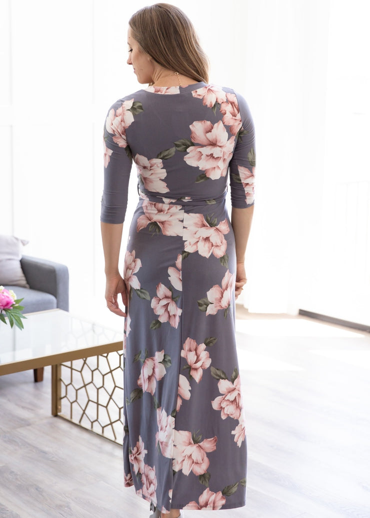 Nichole is wearing our charcoal grey, floral maxi dress!