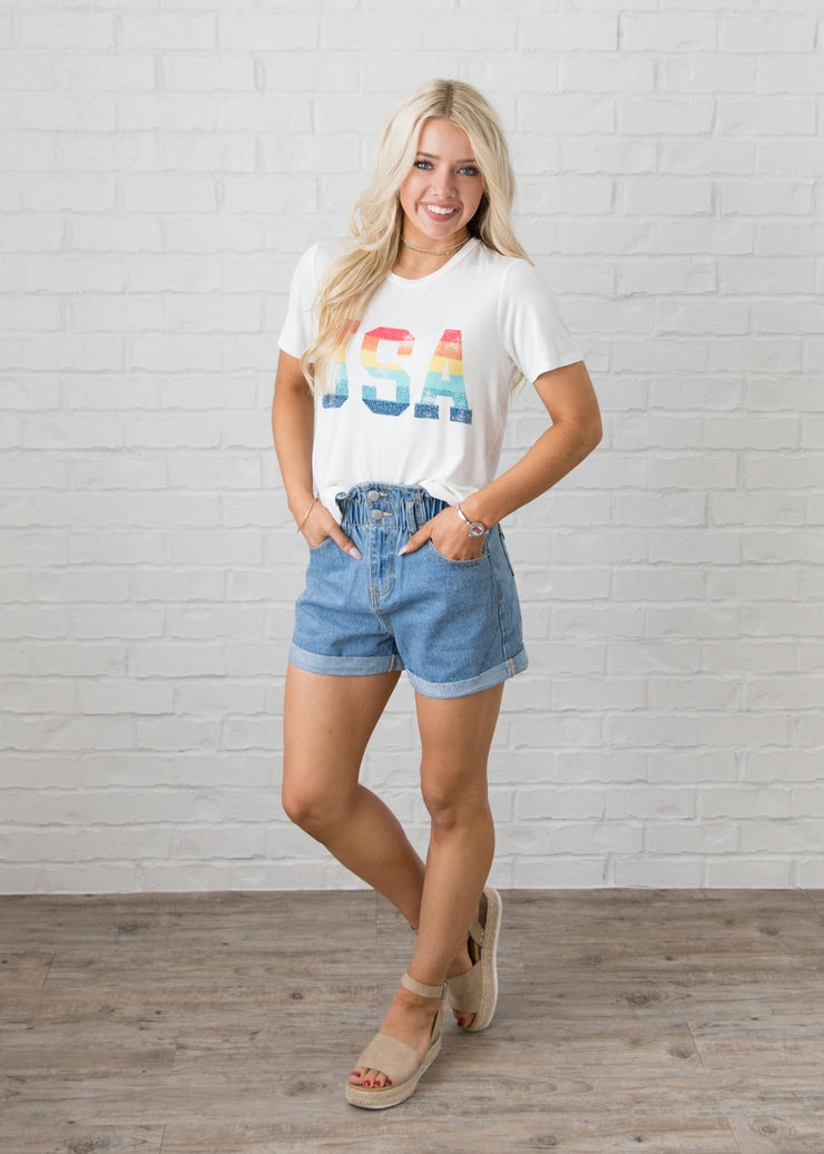 Courtney is wearing our vintage style, high-waisted shorts paired with a 'USA' t-shirt and sandals.