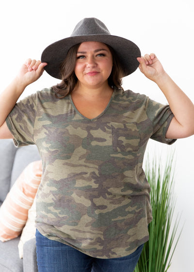 Our model is wearing our camouflage top paired with jeans, a hat and booties!