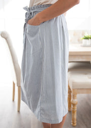 This is our blue stripe, tie waist skirt paired with a white top and heels!