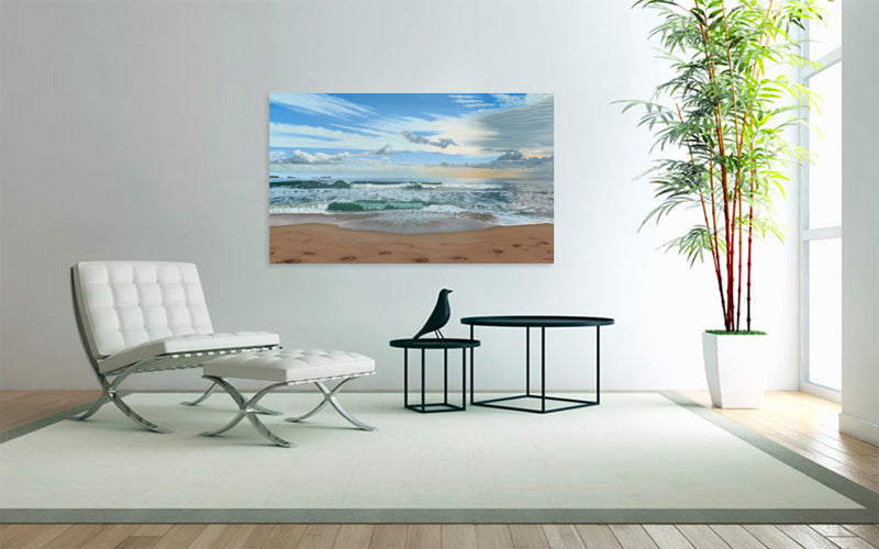 Art for a hotel interior hanging on a white wall with white leather chair nearby. The hotel art picture features a painting of the sea on an art canvas