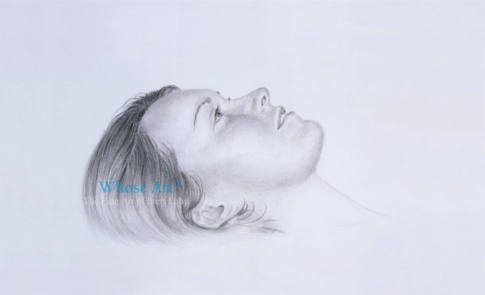 Dreaming pencil drawing showing a young woman daydreaming as she lies with her eyes open. She is peaceful & preoccupied