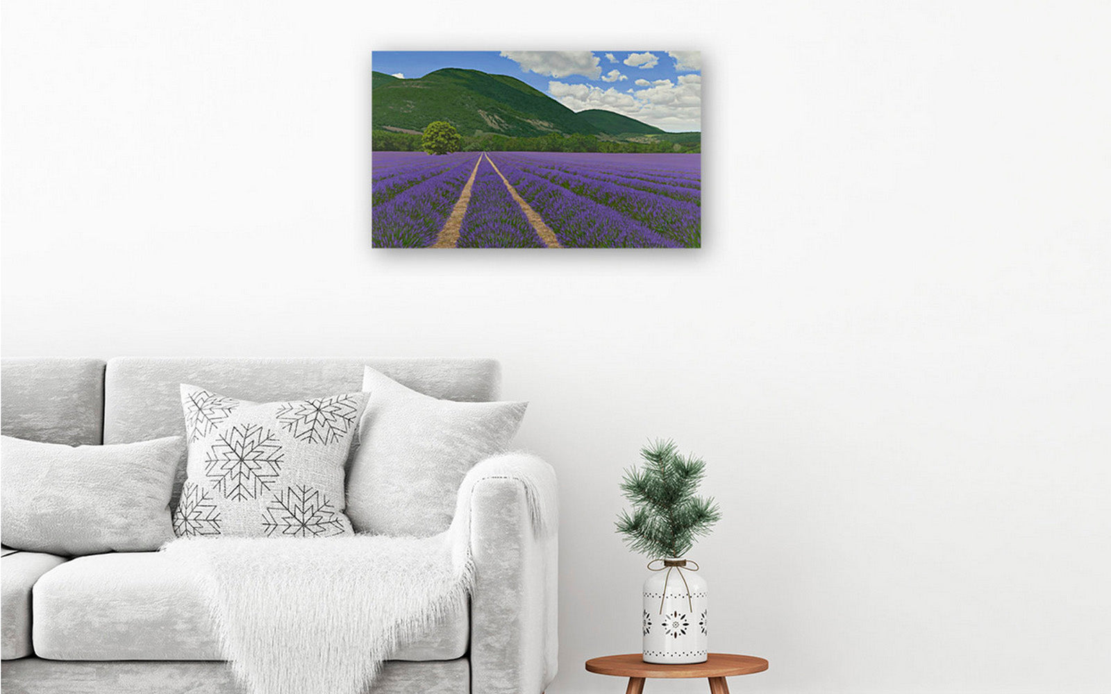 Hotel art picture of a beautiful canvas painting of lavender fields hanging on a hotel bedroom wall above an armchair. The hotel art painting is like a window.