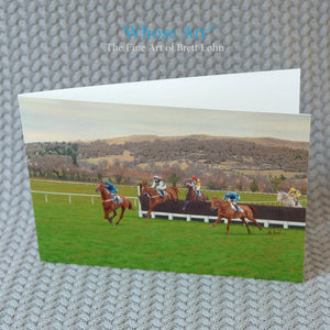 Cheltenham Racecourse greeting Card with a painting of horses jumping at Cheltenham with Cleeve Hill in the background