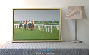 Epsom races are painted on this Canvas art print framed in gold. Horses gallop around a bend beneath a stormy summer sky.