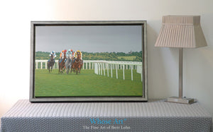 A Horse Racing Canvas wall art print placed in an interior design setting. The Horse Art print depicts evening racing at Epsom