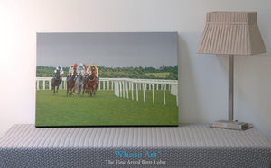 Racehorse wall art canvas print of horses racing at Epsom during an evening meeting. A grey horse leads the field around a bend