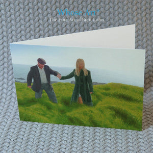 Art greeting card of a painting of an Irish art scene showing a man being gently guided by the hand through long grass
