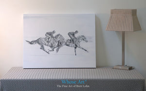 Black & white horse art canvas print, resting on a table, depicting a pencil drawing of 2 horses in training on the gallops.