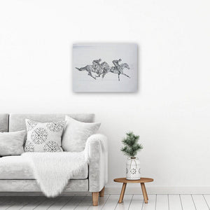 Black and white horse art picture on canvas, showing a pencil drawing of two horses galloping. It hangs unframed in an interior