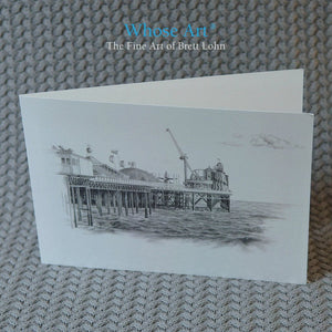 Brighton Festival Art Card with a drawing of the Palace Pier funfair on the front. The greeting card is blank inside.