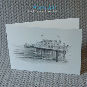 Brighton Pier Greeting Card, blank inside, standing on a table, featuring a pencil drawing of Brighton's Palace Pier.