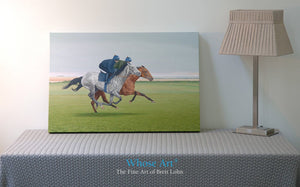 Canvas Horse art print showing a painting of a bay and grey racehorse exercising on the gallops. Rests in an interior setting