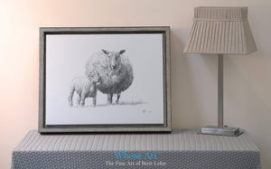 Canvas picture fine art print featuring sheep art. A black & white canvas print of a drawing of sheep and lamb framed silver.