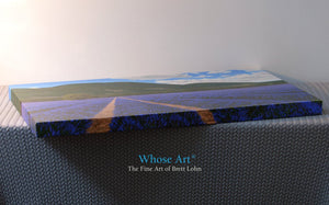 Canvas art print in gallery wrap with 38mm stretchers showing a painting of sunny lavender fields. Canvas lies flat on a table
