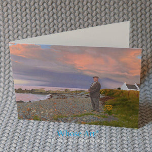 A Fine Art greeting card of a brooding painting of a man on a beach at dusk as a storm gathers. The card is blank inside