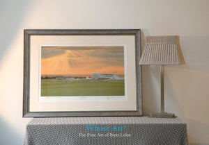 A Framed horse racing art print of Epsom Downs beneath a stormy sunset as the final evening race concludes in the distance.