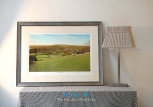 A Framed landscape wall art print of a painted autumnal landscape, showing the view from Box Hill across the south Downs.