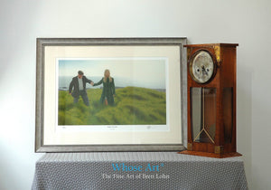 Framed mental health wall art picture of a hopeful lady in the sun, leading a man towards freedom on a grassy beach.