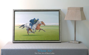 Canvas art print of a Galloping Grey Horse painting showing racehorses working on the gallops. Canvas print rests on a table.