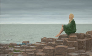 Giants Causeway wall art print of a painting of lady in a green coat sitting on the Giant's Causeway with a heavy sea behind.