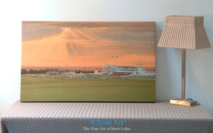 Horse racing Derby canvas art print displayed on a table leaning against a wall. The canvas print features racing at Epsom
