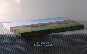 Horses canvas gallery wrap. This horse art print is laying flat on a table to display the canvas edges. Painting is of horses